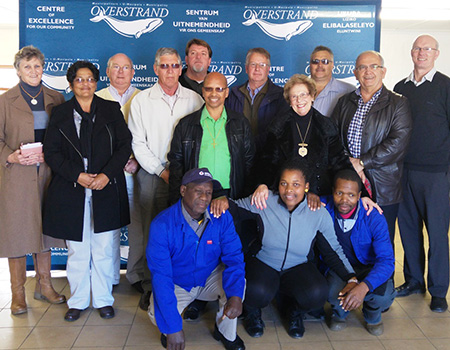 Pictured standing from left: Cllr Lisel Krige, Cllr Moira Opperman, Cllr Dudley Coetzee, Ald Phillipus Appelgrein, Koos Du Plessie, Cllr Rudolph Smith, (Overstrand Deputy Mayor), Abrie Hickman (Adenco), Ald Nicolette Botha-Guthrie (Overstrand Mayor), Danie Fourie (Auricon) Coenie Groenewald (Overstrand Municipal Manager), Stephen Muller (Dir Infrastructure and Planning)  Sitting: Mlindeni Mkrabalala, Noluvuyo Qobani and Ntobeko Msheqo (community members)