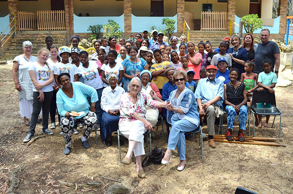 Photo caption: Pictured centre are local benefactor, Mrs von Maltzahn and Executive Mayor, Nicolette Botha-Guthrie flanked by members of the Handevat Marimba Band (far left, second and third rows), Ward Councillor Lianda Beyers-Cronje (far right, fifth row), Camphill Farm Community members and residents and children of Karwyderskraal for whom the Annual Children's Christmas was thrown.